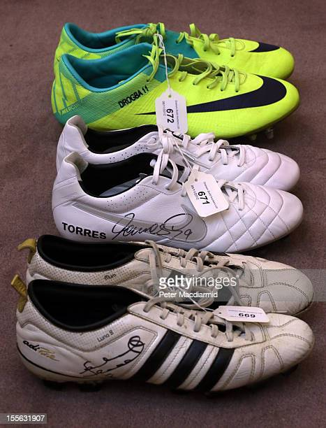 Pairs of football boots worn by Didier Drogba Fernando Torres and Frank Lampard are shown at Sotheby's on November 6 2012 in London England Graham...