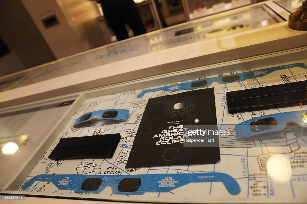 Pairs of free solar eclipse glasses sit on display at a Warby Parker store on August 11, 2017 in New York City. To view the upcoming total solar eclipse on August 21 eye protection is essential. The designer eyeglass store expects to give out thousands of pairs of the glasses before the event.