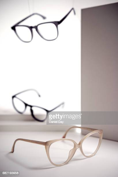 3 pairs of glasses placed and suspended in an empty space