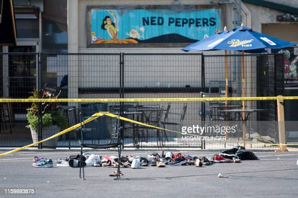 Pairs of shoes are piled behind the Ned Peppers bar belonging to victims of an active shooting that took place in Dayton Ohio on August 04 2019 Nine...