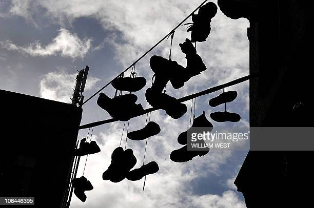 Pairs of shoes hanging from powerlines running between two building in a laneway in Melbourne's CBD on April 15 2009 Passerbys are not sure whether...