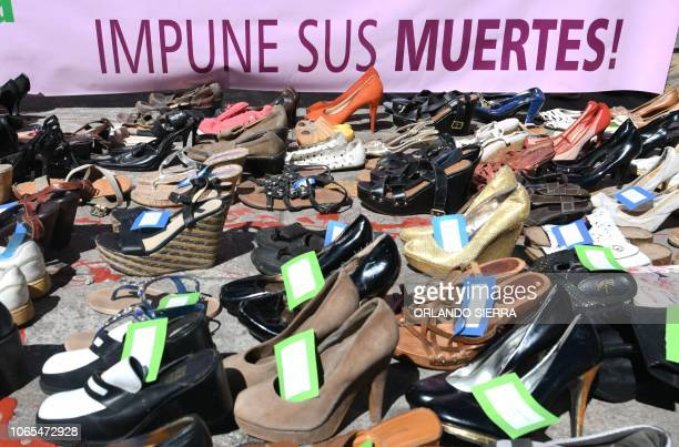 Pairs of shows of murdered women are seen during a demonstration demanding justice for the 5929 women killed in the past 15 years in Honduras in the...