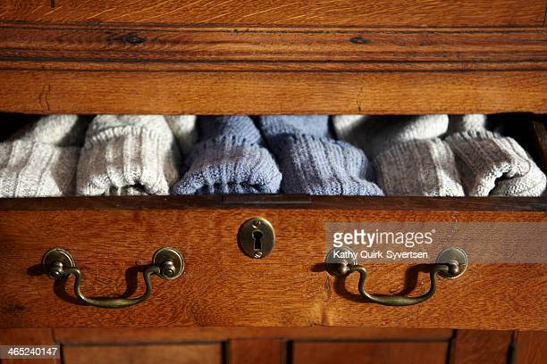 pairs of wool socks in open drawer - drawer stock pictures, royalty-free photos & images