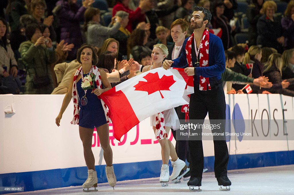 Pairs winner Meagan Duhamel and Eric Radford of Canada skate with the Canadian flag on day two of Skate Canada International ISU Grand Prix of Figure Skating, October, 31, 2015 at ENMAX Centre in Lethbridge, Alberta, Canada.
