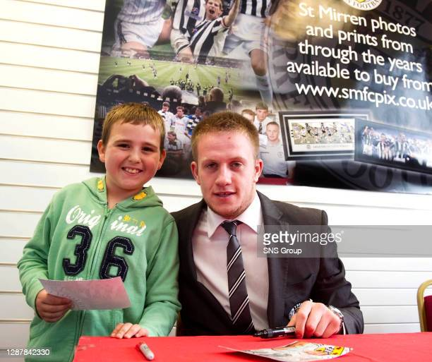 St Mirren ace Grant Adam meets with a young fan prior to kick-off.