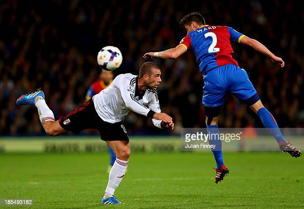 Pajtim Kasami of Fulham and Joel Ward of Crystal Palace compete for the ball during the Barclays Premier League match between Crystal Palace and...
