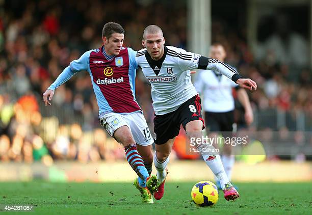 Pajtim Kasami of Fulham is pursued by Ashley Westwood of Aston Villa during the Barclays Premier League match between Fulham and Aston Villa at...
