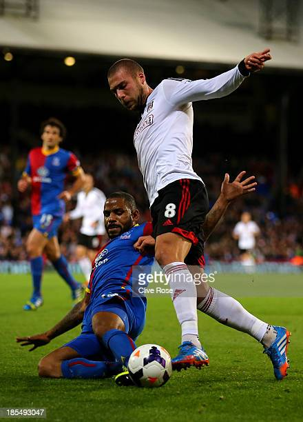 Pajtim Kasami of Fulham is tackled by Jason Puncheon of Crystal Palace during the Barclays Premier League match between Crystal Palace and Fulham at...