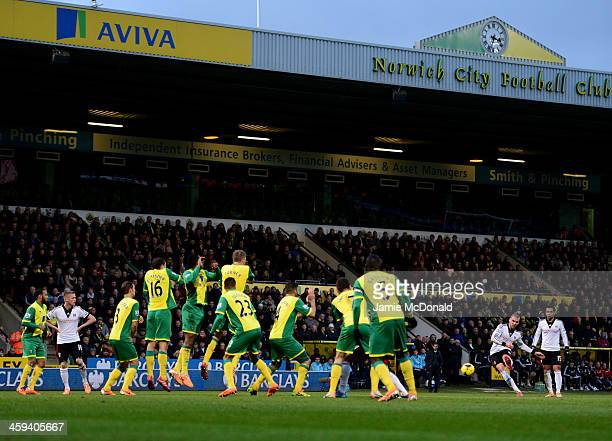 Pajtim Kasami of Fulham shoots from a free kick to score their first goal during the Barclays Premier League match between Norwich City and Fulham at...