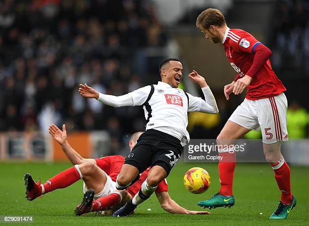 Pajtim Kasami of Nottingham Forest and Marcus Olsson of Derby County fight for the ball during the Sky Bet Championship match between Derby County...