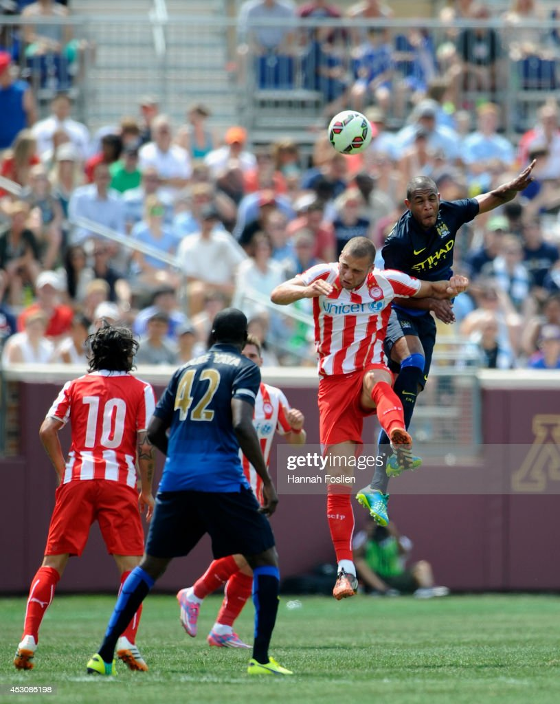 Pajtim Kasami #11 of Olympiacos and Fernando #6 of Manchester City go after the ball during the first half of the International Champions Cup match on August 2, 2014 at TCF Bank Stadium in Minneapolis, Minnesota. The Olympiacos defeated the Manchester City in a penalty shootout.