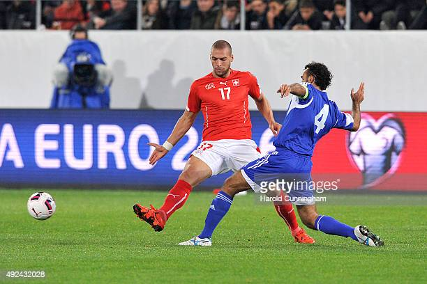 Pajtim Kasami of Switzerland and Alessandro Della Valle of San Marino in action during the UEFA EURO 2016 qualifier between Switzerland and San...