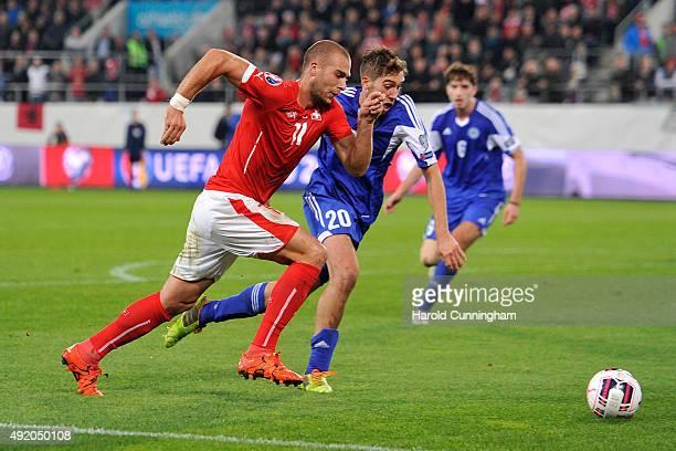 Pajtim Kasami of Switzerland and Luca Tosi of San Marino during the UEFA EURO 2016 qualifier between Switzerland and San Marino at AFG Arena on...