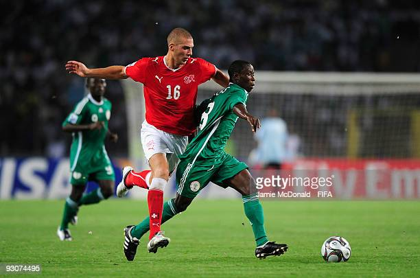 Pajtim Kasami of Switzerland battles with Stanley Okoro of Nigeria during the FIFA U17 World Cup during the FIFA U17 World Cup Final match between...