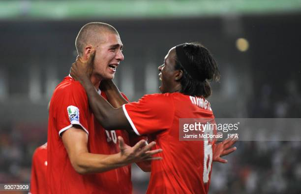 Pajtim Kasami of Switzerland celebrates at the final whistle with Kofi Nimeley as they win the FIFA U17 World Cup during the FIFA U17 World Cup Final...