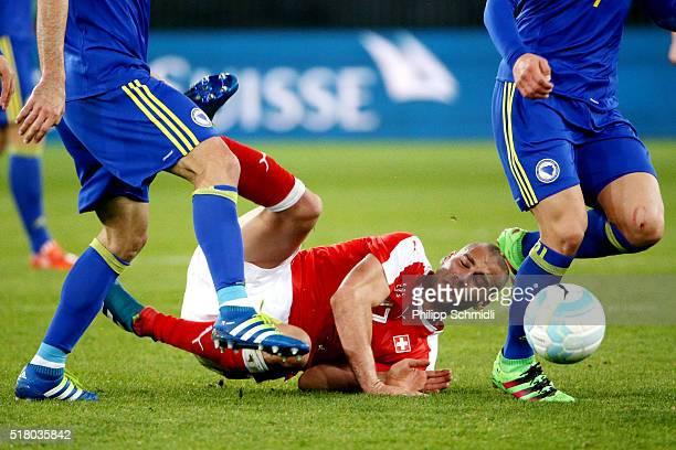Pajtim Kasami of Switzerland is fouled during the international friendly match between Switzerland and BosniaHerzegovina at Stadium Letzigrund on...