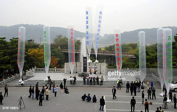Paju South Korea People including defectors from North Korea release large balloons carrying about 200000 leaflets criticizing the North's government...