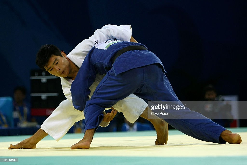 Pak Chol Min of North Korea holds Mirali Sharipov of Uzbekistan in the Men's -66 kg judo event during day 2 of the Beijing 2008 Olympic Games at the University of Science and Technology Beijing Gymnasium on August 10, 2008 in Beijing, China.