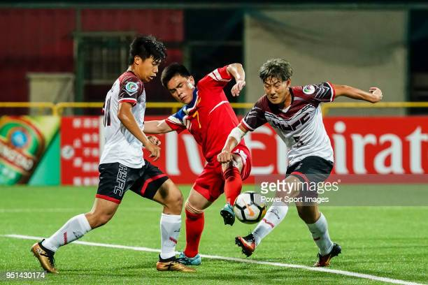 Pak Chol Song of Hwaepul SC fights for the ball with Huang Shihyuan of Hang Yuen FC during the AFC Cup Group I match between Hang Yuen and Hwaepul at...
