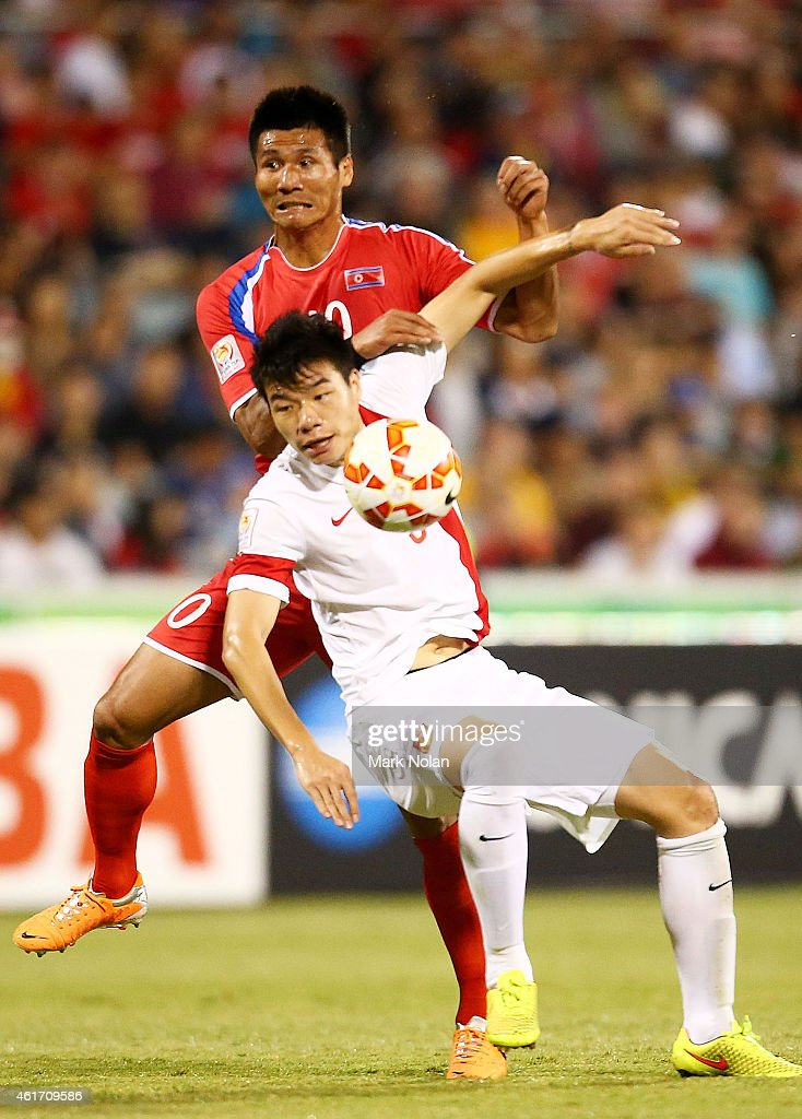 Pak Kwang Ryong of DPR Korea and Mei Fang of China contest possession during the 2015 Asian Cup match between China PR and DPR Korea at Canberra Stadium on January 18, 2015 in Canberra, Australia.