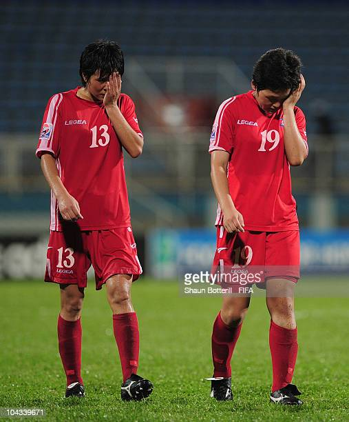 Pak Kyong Mi and Kim Nam Hui of North Korea are dejected at the end of the FIFA U17 Women's World Cup Semi Final match between North Korea and Japan...