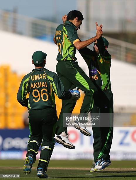 Pakisani bowler Umar Gul celebrates with teammates after dismissing batsman Tillakaratne Dilshan of Sri Lanka during the fourth One Day International...