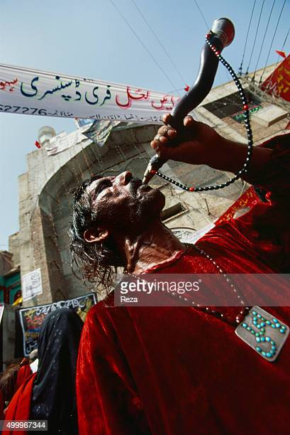 2006 Pakistan A man makes the call to prayer by blowing into a hollowed antelope horn at the shrine of the 13thcentury Sufi saint Lal Shahbaz...
