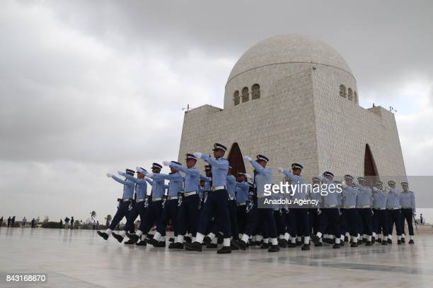 Pakistan Air Force cadets march at the mausoleum of the country's founder Mohammad Ali Jinnah during celebrations to mark the 52nd anniversary of...