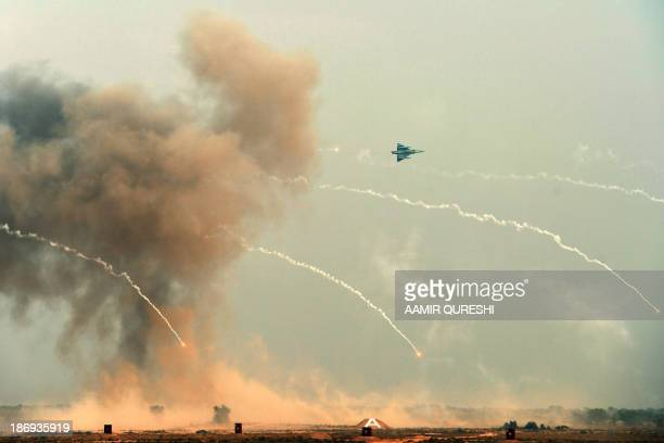 """Pakistan Air Force Dassault Mirage aircraft banks while dropping flares during the Azm-e-Nau-4"""" military exercise in Khairpure Tamay Wali in..."""