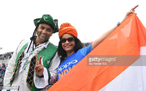 Pakistan and India fan pictured together during the Group Stage match of the ICC Cricket World Cup 2019 between India and Pakistan at Old Trafford on...
