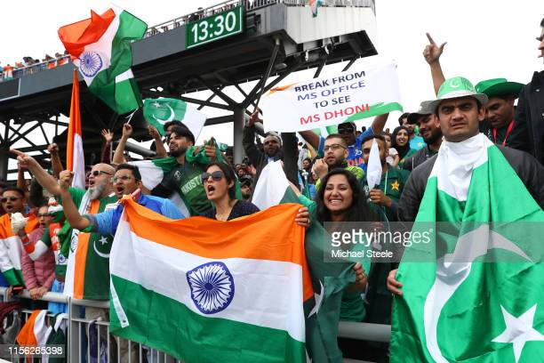Pakistan and India supporters in full voice during the Group Stage match of the ICC Cricket World Cup 2019 between India and Pakistan at Old Trafford...