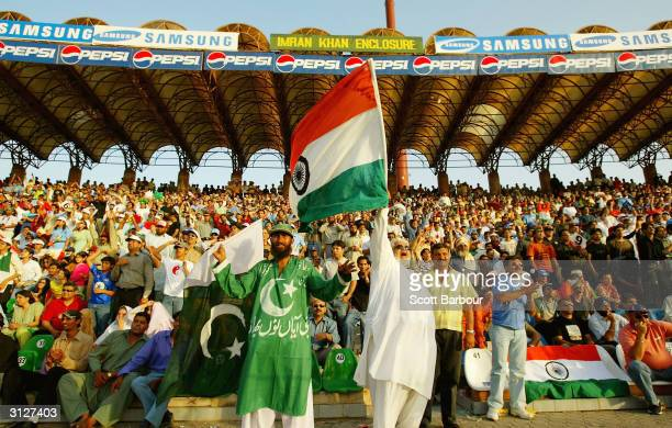Pakistan and India supporters watch the match in the stands during the fifth Pakistan v India oneday international match played at the Gadaffi...