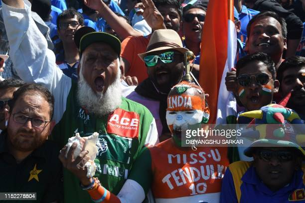 Pakistan and Indian super fans cheer during the 2019 Cricket World Cup group stage match between West Indies and India at Old Trafford in Manchester...
