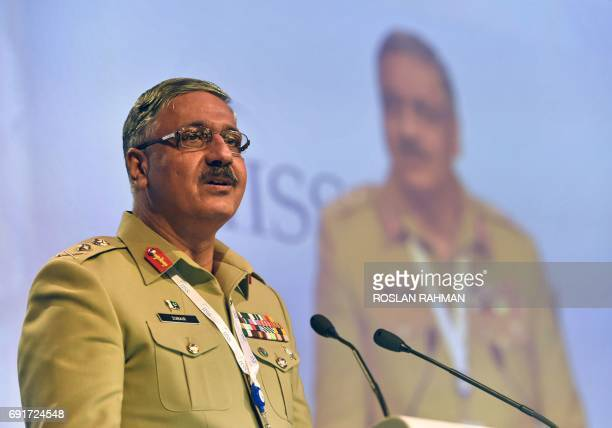 Pakistan Armed Forces' Chairman Joint Chiefs of Staff Committee General Zubair Mahmood Hayat speaks during the third plenary session at the 16th...
