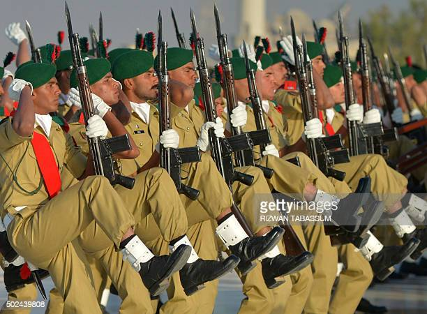Pakistan army cadets take part in a guard of honour during an event to mark the birth anniversary of Pakistan's founder Mohammad Ali Jinnah in...