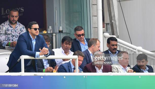 Pakistan Army Chief General Qamar Javed Bajwa looks on with others during the 2019 Cricket World Cup group stage match between Pakistan and South...