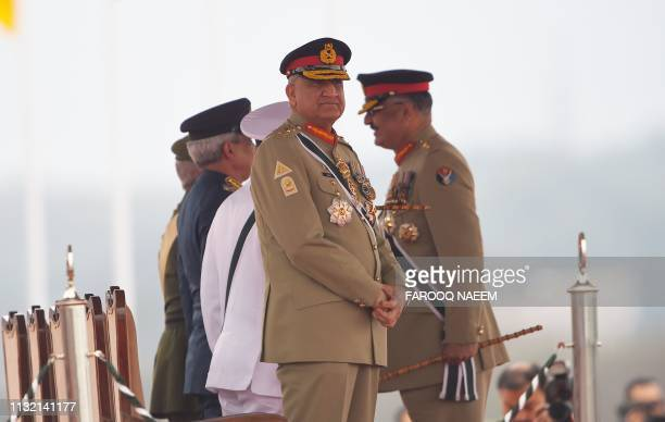 Pakistan Army Chief General Qamar Javed Bajwa stands before the start of the Pakistan Day parade in Islamabad on March 23 2019 Pakistan National Day...