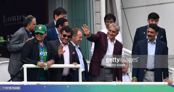 Pakistan Army Chief General Qamar Javed Bajwa waves to the crowd during the 2019 Cricket World Cup group stage match between Pakistan and South...