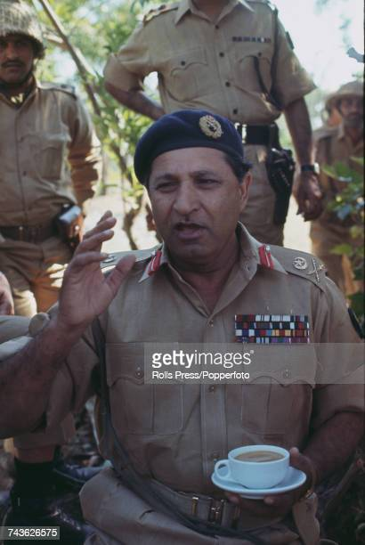 Pakistan Army general Amir Abdullah Khan Niazi pictured holding a cup of tea as he visits front line troops in the vicinity of Hilli East Pakistan on...