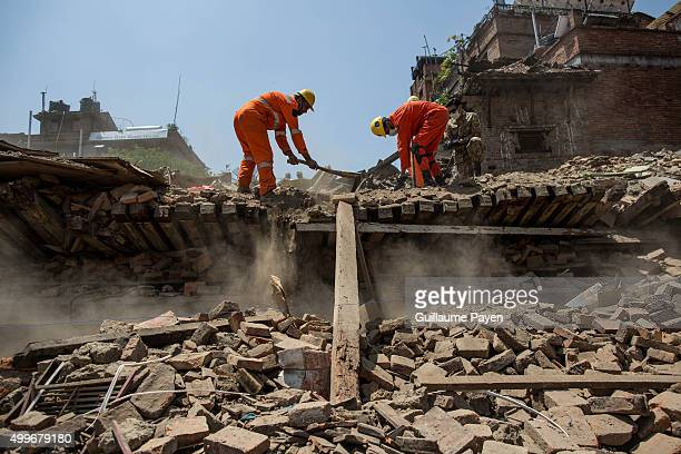 Pakistan Army help to find the last body of an alleged Chinese tourist inside the rubble at the Bhaktapur Durbar Square. The death toll has risen to...