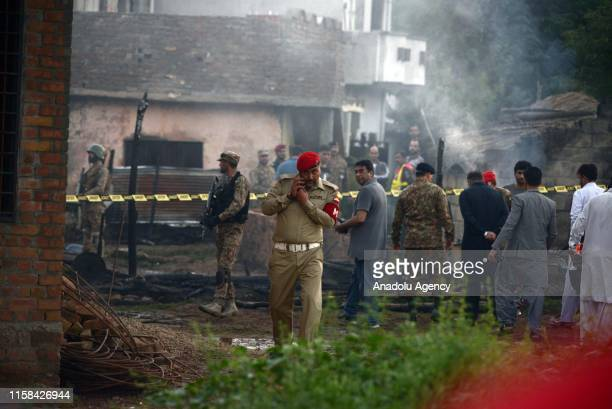 Pakistan army officials visit the site of a plane crash an Rawalpindi, Pakistan on July 30, 2019. Fifteen people were killed when a Pakistan Aviation...