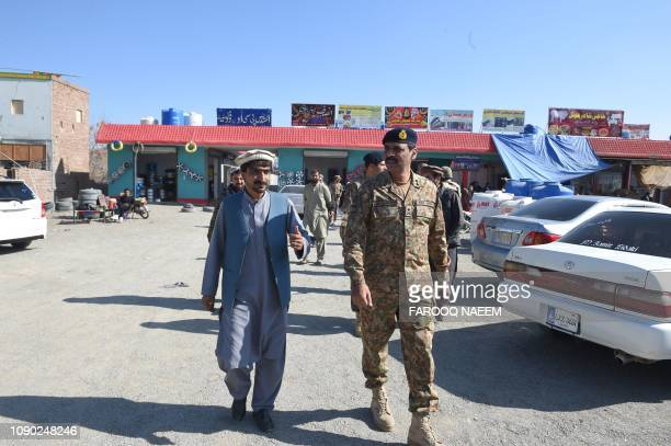 Pakistan army spokesperson Major General Asif Ghafoor visits a market in Miran Shah a town in North Waziristan near the border between Pakistan and...