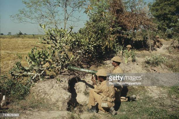 View of Pakistan Army troops with mortars and small arms in defensive positions as they face Indian Army forces at Dangapara in East Pakistan on 27th...