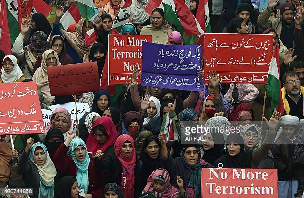 Pakistan Awami Tehreek activists rally for the victims of the Peshawar school massacre in Lahore on December 21 2014 AlQaeda's regional branch on...