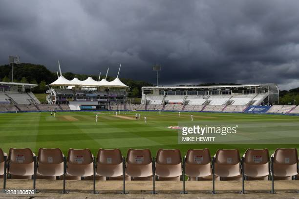 Pakistan bat under a stormy sky in the empty ground during the morning session on the fourth day of the third Test cricket match between England and...