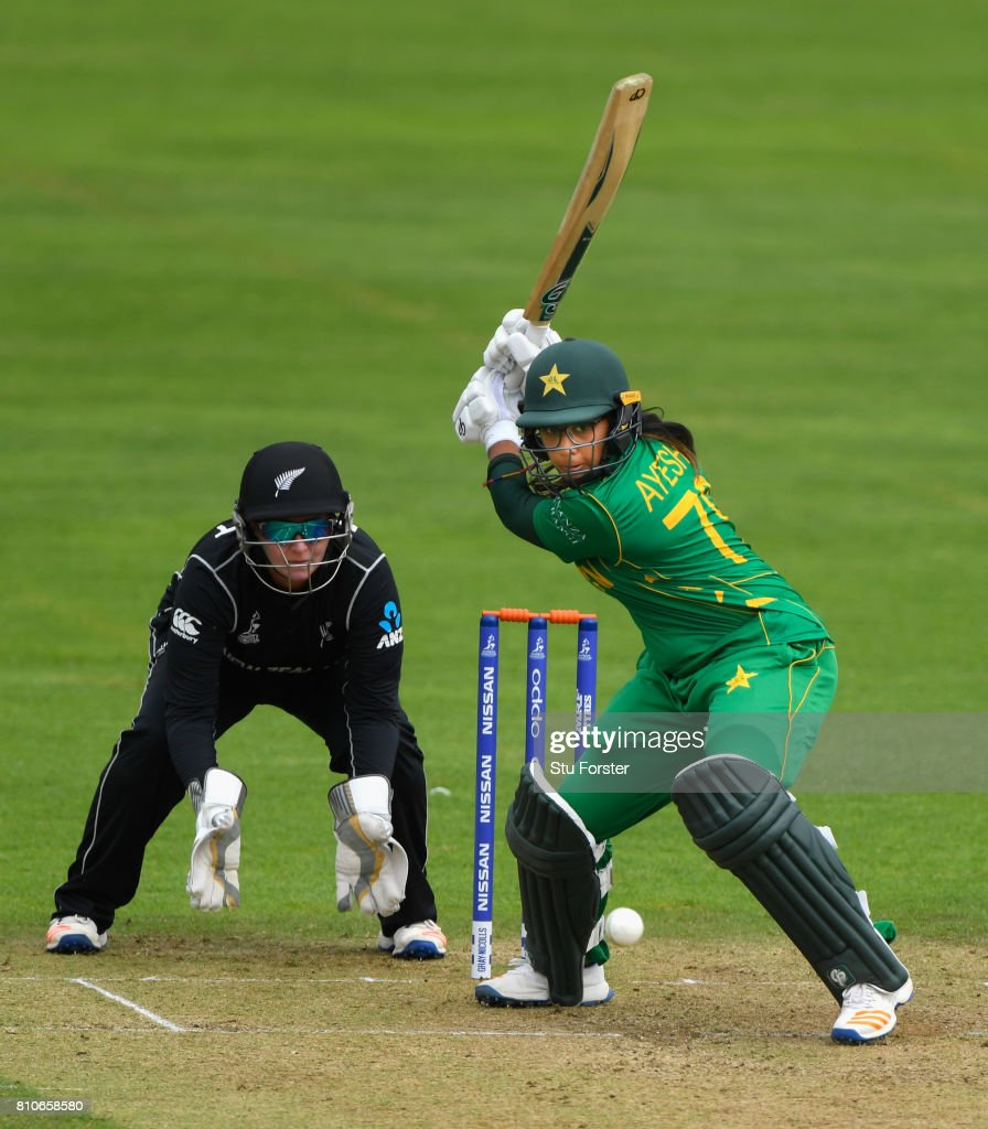 Pakistan batsman Ayesha Zafar hits out watched by New Zealand wicketkeeper Rachel Priest during the ICC Women's World Cup 2017 match between New Zealand and Pakistan at The Cooper Associates County Ground on July 8, 2017 in Taunton, England.