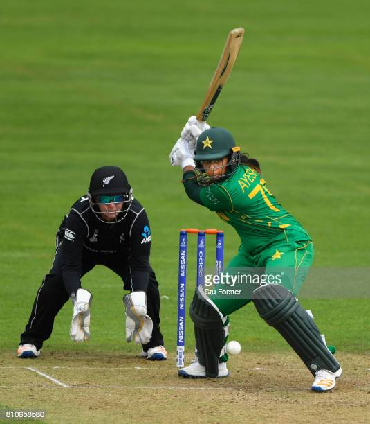 Pakistan batsman Ayesha Zafar hits out watched by New Zealand wicketkeeper Rachel Priest during the ICC Women's World Cup 2017 match between New...