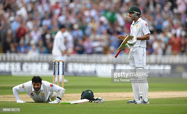 Pakistan batsman Azhar Ali celebrates his century with press ups as batting partner Younis Khan applauds during day two of the 3rd Investec Test...