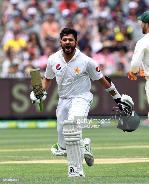 Pakistan batsman Azhar Ali celebrates scoring his double century against Australia on the third day of the second cricket Test match in Melbourne on...