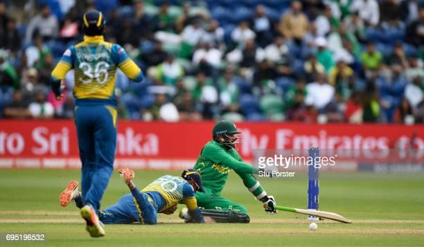 Pakistan batsman Azhar Ali clashes with Dhanushka Gunathilleke of Sri Lanka whilst going for a quick single during the ICC Champions League match...